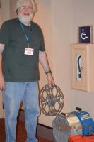 Projectionist Mark Wojan with The Three Stooges 35mm film prints