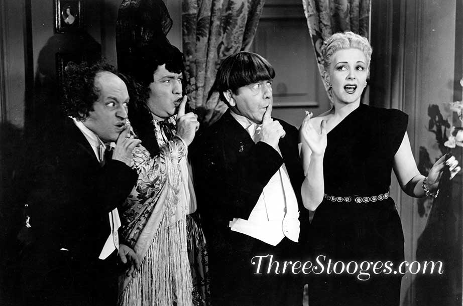 McIntyre in a publicity still with Larry, Curly and Moe from Micro-Pho